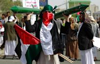 A Yemeni supporter of the Shiite Huthi movement carries Palestinian flags and models of rockets during a rally to mark the Quds (Jerusalem) International day, in support of Palestinians, on July 10, 2015 in the capital Sanaa (AFP Photo/Mohammed Huwais)