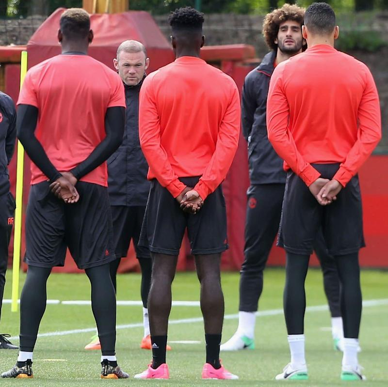 The Manchester United squad hold a minute's silence in honour of the victims of the attack at Manchester Arena ahead of a first team training session, ahead of the UEFA Europa League Final - Credit: John Peters/Man Utd/Getty