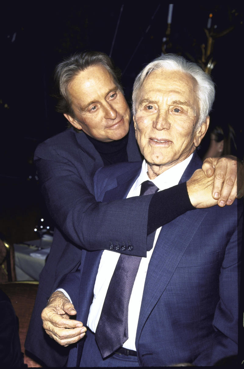 (L-R) Actor Michael Douglas and his father, actor Kirk Douglas, at a film premiere of Kirk's Diamonds in December 1999. | Dave Allocca—The LIFE Picture Collection via Getty Images