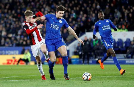 FILE PHOTO - Soccer Football - FA Cup Fifth Round - Leicester City vs Sheffield United - King Power Stadium, Leicester, Britain - February 16, 2018 Leicester City's Harry Maguire in action with Sheffield United's David Brooks REUTERS/Darren Staples