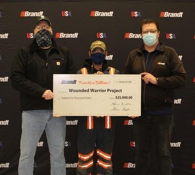 Dan Miller of the Wounded Warrior Project accepting Brandt's $25,000 donation as part of their Thanks A Billion Holiday Fund (CNW Group/Brandt Group of Companies)