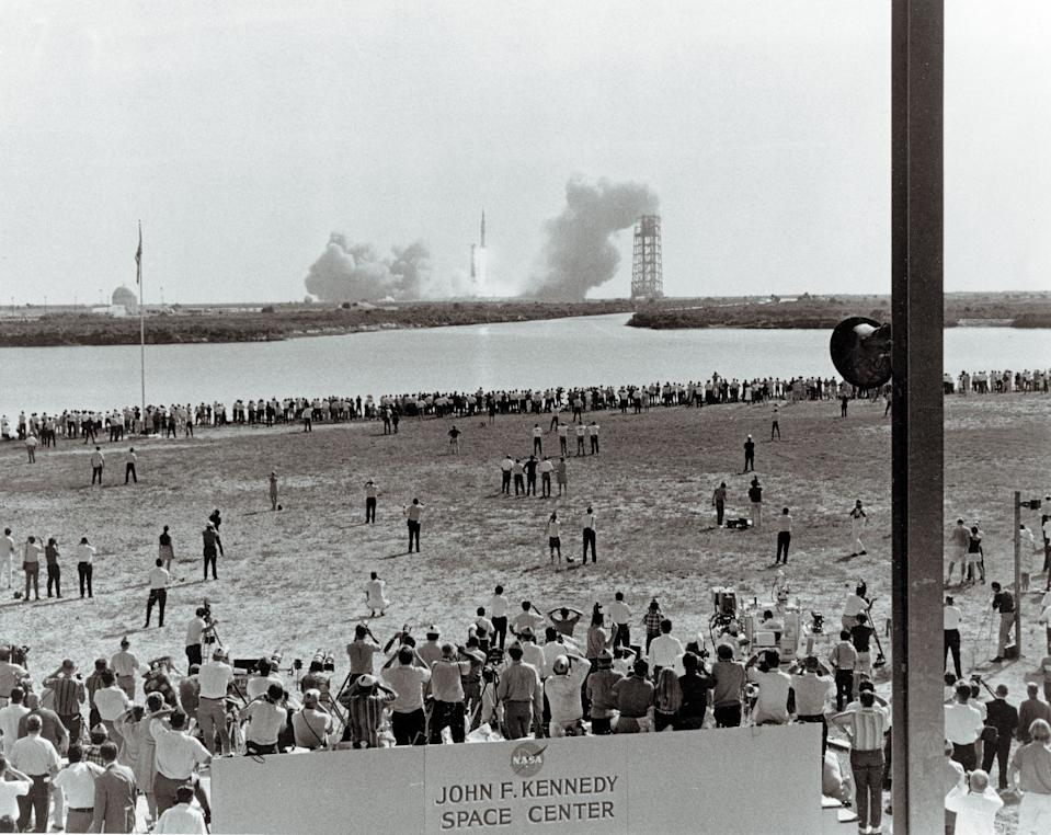 This NASA handout picture taken on July 16, 1969, shows some of the thousands of people who camped out on beaches and roads adjacent to the Kennedy Space Center to watch the Apollo 11 mission Liftoff aboard the Saturn V rocket. (Photo: NASA/AFP/Getty Images)