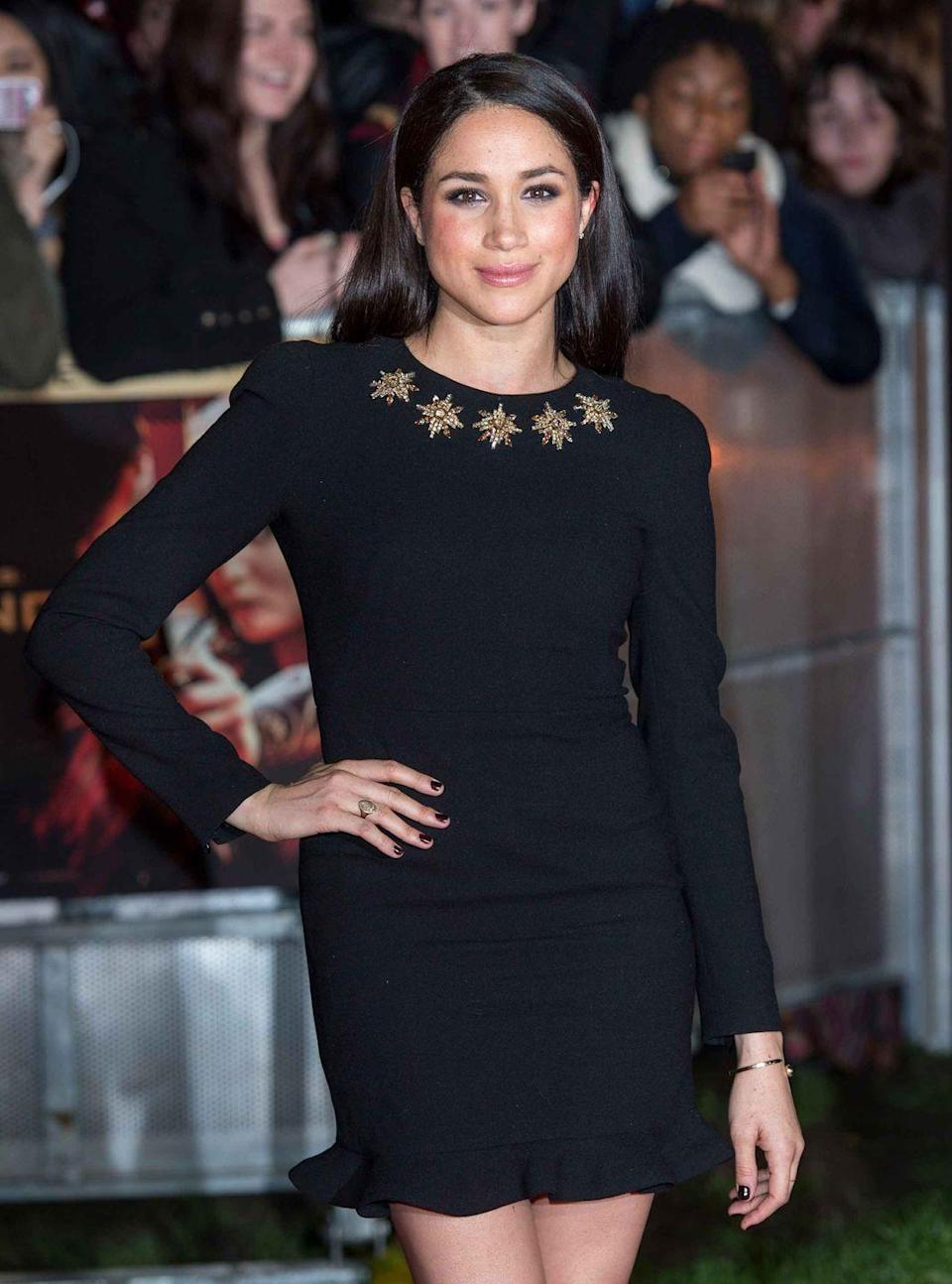 <p>Posing on the red carpet at the premiere of <em>Hunger Games: Catching Fire </em>in London, England.</p>