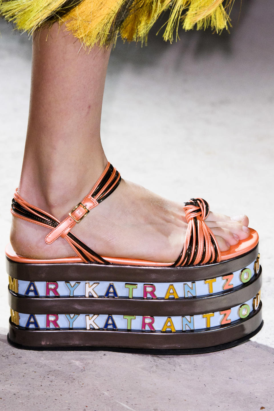 <p><i>Colorful platform heels embellished with the designer's name from the SS18 Mary Katrantzou collection. (Photo: ImaxTree) </i></p>
