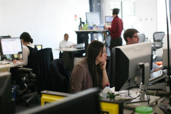 Employees are shown in their working environment at the new headquarters of Facebook in Menlo Park, California January 11, 2012.