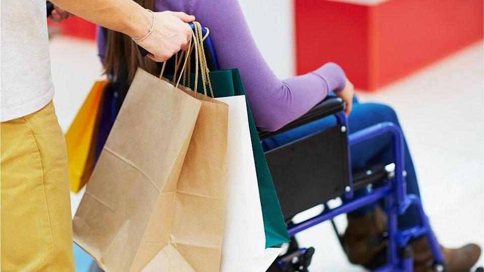 Shopping bags and person in wheelchair