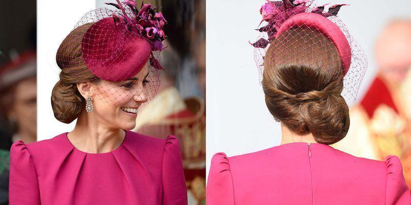 <p>For Princess Eugenie's wedding, Kate Middleton topped off her twisted side bun with a magenta fascinator.</p>