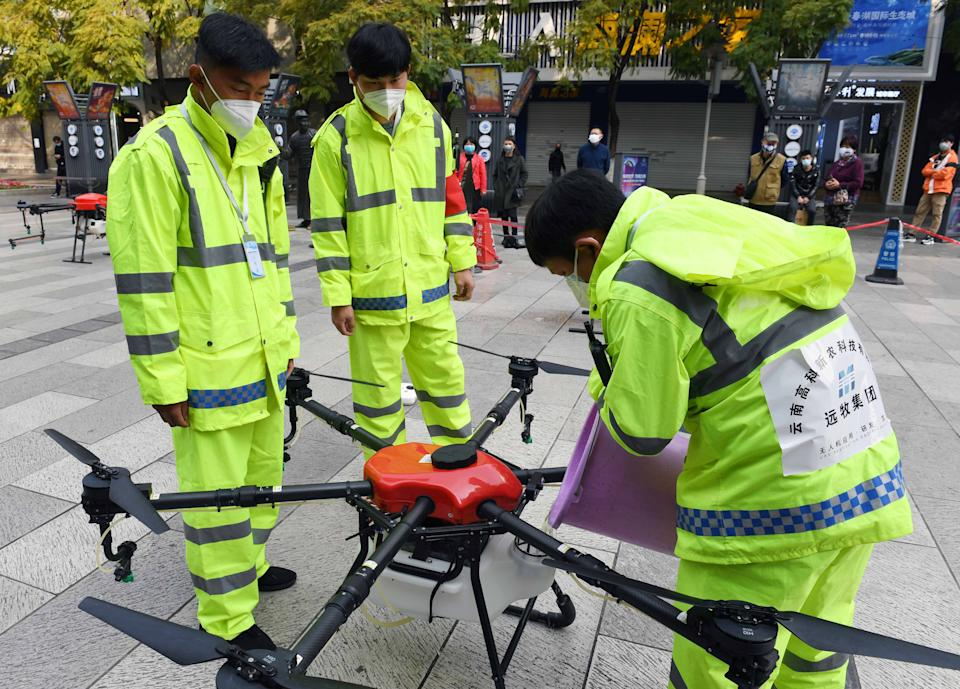 KUNMING, Feb. 27, 2020 -- Staff members refill a drone with disinfectant in Kunming City, southwest China's Yunnan Province, Feb. 27, 2020. Under the guidance of local authorities, eight drones have been assigned to carry out the daily disinfection work against novel coronavirus outbreak since Feb. 10 in some public areas of the city. (Photo by Yang Zongyou/Xinhua via Getty)