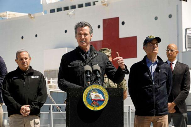PHOTO: California Governor Gavin Newsom speaks in front of the hospital ship USNS Mercy that arrived into the Port of Los Angeles on Friday, March 27, 2020. (Carolyn Cole-Pool/Getty Images)
