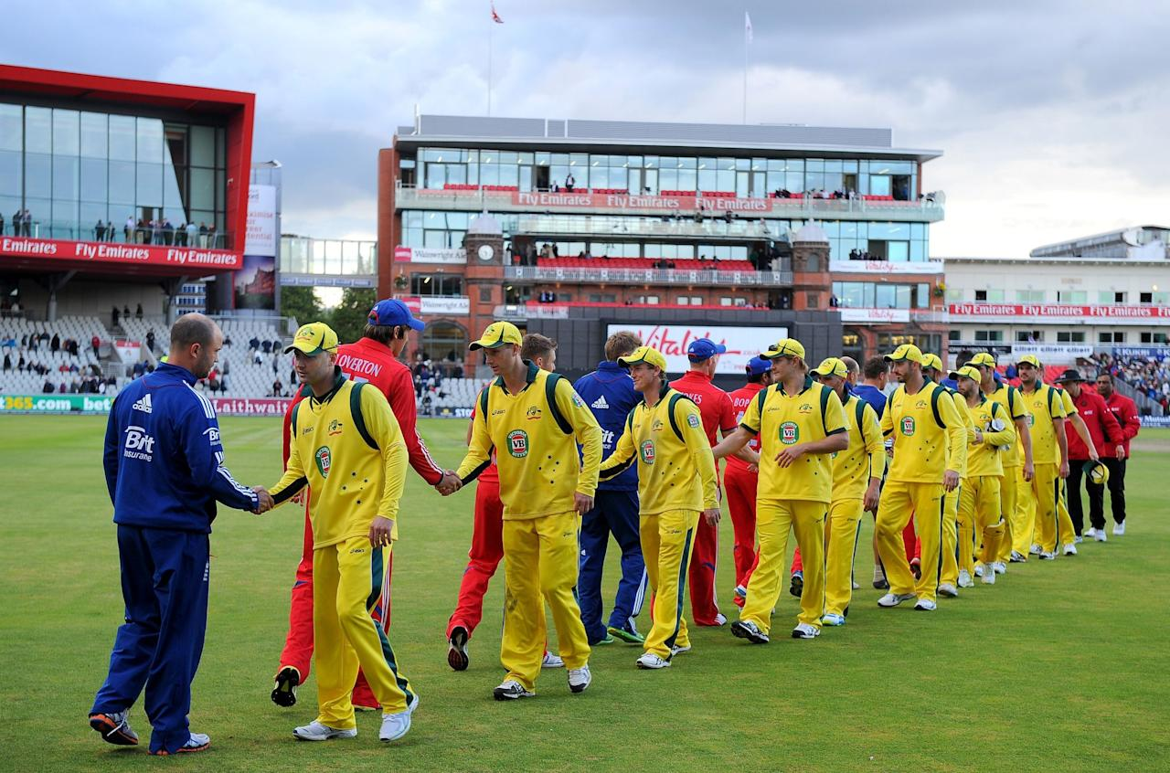 The Australia team led by Michael Clarke shake hands with the England team after their victory in the Second One Day International at Old Trafford Cricket Ground, Manchester.