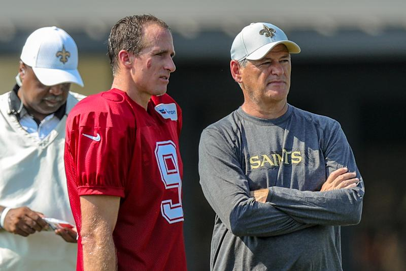New Orleans Saints general manager Mickey Loomis, right, implied on Monday that quarterback Drew Brees can play for the team for as long as he'd like to keep playing. (Getty Images)