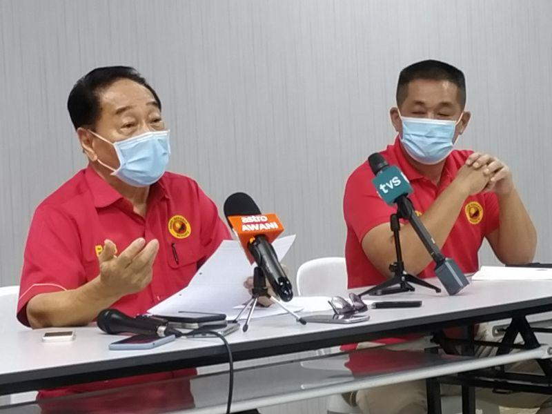 Parti Sarawak Bersatu president Datuk Sri Wong Soon Koh (left), seen with Batu Lintang assemblyman See Chee How, speaks during a press conference March 9, 2021. — Picture by Sulok Tawie