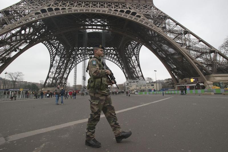A French soldiers patrols infront of the Eiffel tower, Sunday, Jan. 13, 2013. France has ordered tightened security in public buildings and transport following action against radical Islamists both in Mali and Somalia, French President Francois Hollande said yesterday. (AP Photo/Michel Euler)
