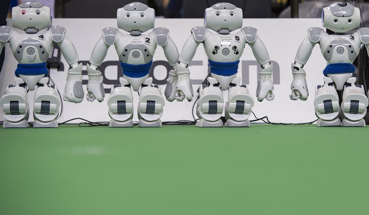 MAGDEBURG, GERMANY - APRIL 26:  Robots stand on the play field at the 2013 RoboCup German Open tournament on April 26, 2013 in Magdeburg, Germany. The robots, which are a model called Nao, manufactured by Aldebaran Robotics, perform autonomously and communicate with one another via WLAN. The three-day tournament is hosting 43 international teams and 158 German junior teams that compete in a variety of disciplines, including soccer, rescue and dance.  (Photo by Jens Schlueter/Getty Images)