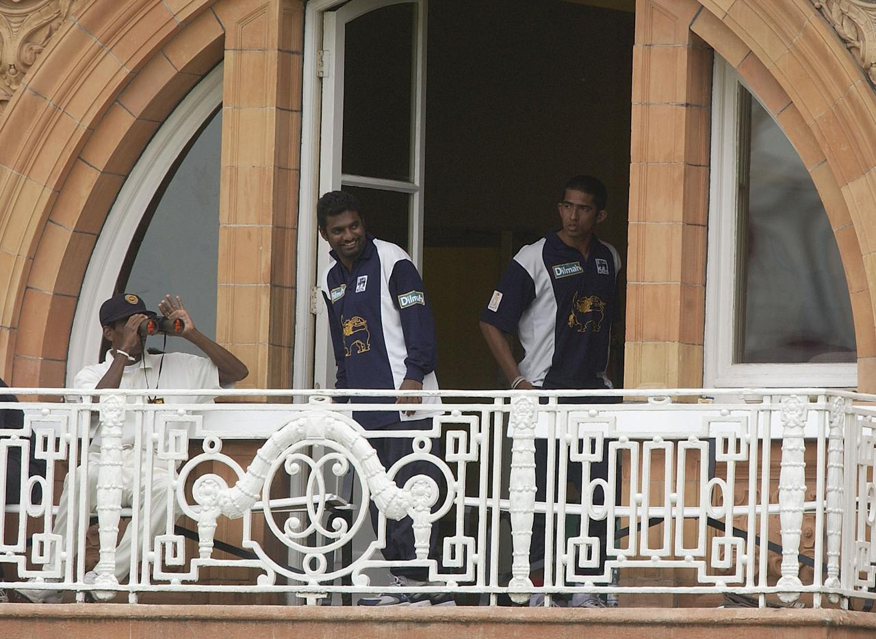 LONDON - MAY 19:  Sri Lankan spin bowler Muttiah Muralitharan watches from the pavilion during the fourth day of the first Test Match between England and Sri Lanka at Lord's in London on May 19, 2002. (Photo by Tom Shaw/Getty Images)