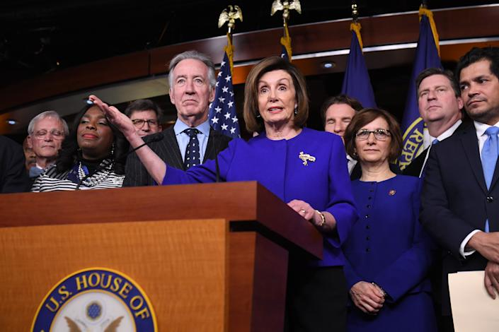 Speaker of the House Nancy Pelosi and House Ways and Means Committee Chairman Richard Neal, Democrat of Massachusetts, speaks about the US - Mexico - Canada Agreement, known as the USMCA, on Capitol Hill in Washington, DC, December 10, 2019. (Photo: Saul Loeb/AFP via Getty Images)