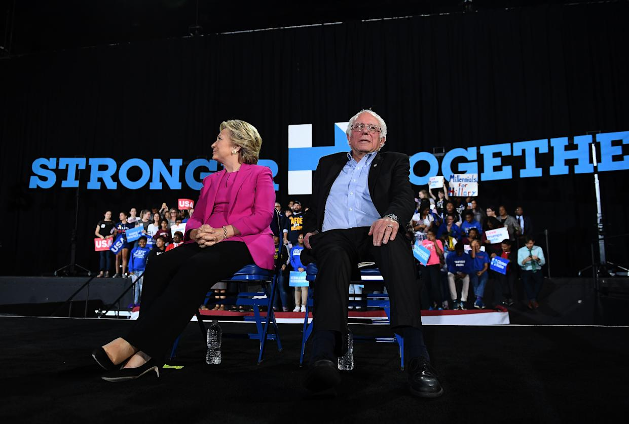 US Democratic presidential nominee Hillary Clinton and Bernie Sanders listen to singer Pharrell Williams during a campaign rally in Raleigh, North Carolina, on November 3, 2016. (Photo: Jewel Samad/AFP via Getty Images)