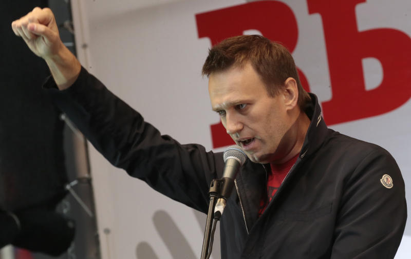 FILE -  In this Saturday, Sept. 15, 2012 file photo Russian opposition leader Alexei Navalny speaks at a protest rally in Moscow. Far from the streets of the capital where he gained international notice as a leader of massive protests, leading Russian opposition figure Alexei Navalny faces trial this week on charges that could send him to prison for ten years. The trial, starting Wednesday in Kirov, 800 kilometers (500 miles) northeast of Moscow, accuses Navalny of leading an organized crime group that embezzled 16 million rubles (US$500,000) worth of timber from a state-run company. The charges not only threaten him with serious prison time, but strike at the essence of his image as a vociferous anti-corruption campaigner. (AP Photo/Mikhail Metzel, file)