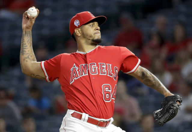 Los Angeles Angels relief pitcher Felix Pena throws against the Texas Rangers during the first inning of a baseball game in Anaheim, Calif., Wednesday, Sept. 12, 2018. (AP Photo/Chris Carlson)