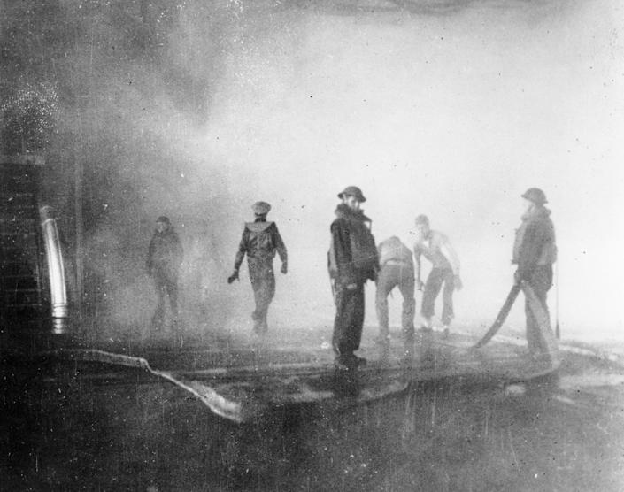 FILE - In this June 4, 1942 file photo crewmen aboard the USS Yorktown battle fire after the carrier was hit by Japanese bombs, during the Battle of Midway. Later the vessel had to be abandoned and was sunk by a Japanese submarine torpedo hit. A group of deep-sea explorers scouring the world's oceans for sunken World War II ships is honing in on sonar readings of debris fields in the Pacific Ocean. A research vessel called the Petrel is launching underwater robots about halfway between the U.S. and Japan in search of warships from the Battle of Midway. (AP Photo, File)