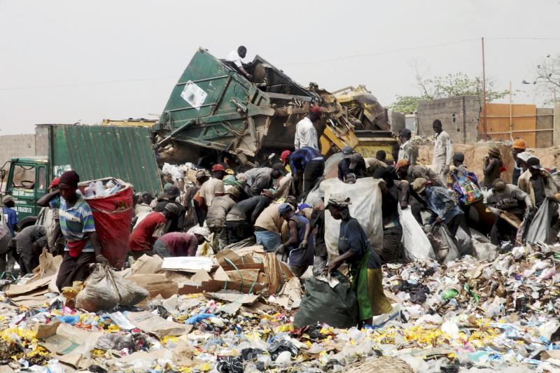 File photo of scavengers picking up trash for recycling at the Olusosun dump site in Lagos