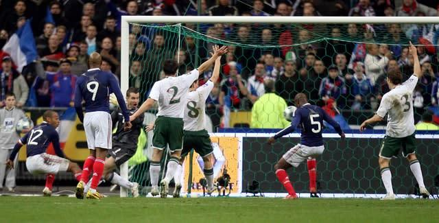 France's William Gallas (second right) scores against Ireland following Thierry Henry's unseen handball (Martin Rickett/PA)
