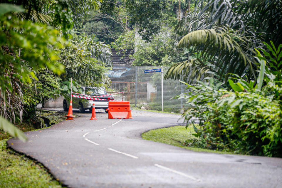 Driving along the narrow roads on Federal Hill, you have to be alert for repairs. ― Picture by Hari Anggara