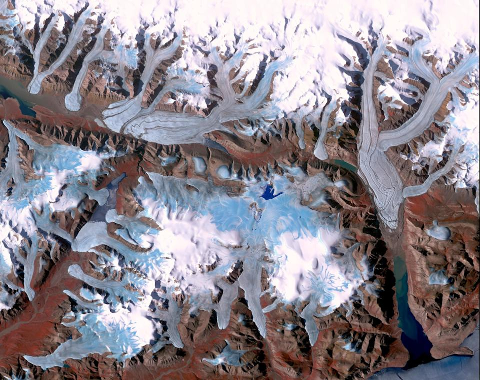 Ellesmere Island is part of the Qikiqtaaluk Region of the Canadian territory of Nunavut with the most northerly point of land in Canada. Inhabited since about 2000 BC, its current population is less than 200. Large portions of Ellesmere Island are covered with glaciers and ice, as seen in this image of a portion of the north-central part of the island.