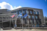 <p>Flags fly at half-staff outside the Scottish Parliament on April 9. </p>