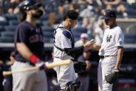 New York Yankees catcher Gary Sanchez, center, hands the ball to relief pitcher Albert Abreu, right, after catching pop out by Cleveland Indians' Austin Hedges, left, in the fifth inning of a baseball game, Saturday, Sept. 18, 2021, in New York. (AP Photo/John Minchillo)