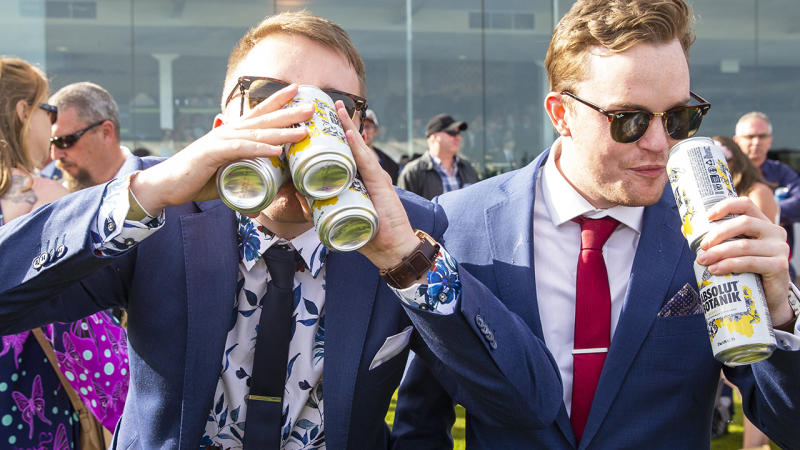 Race-goers, pictured enjoying several beverages at a time, at the 2019 Melbourne Cup.