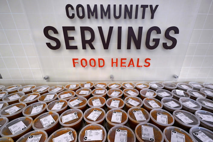 Hundreds of containers of soup are prepared for clients at Community Servings, which prepares and delivers scratch-made, medically tailored meals to individuals & families living with critical & chronic illnesses, Tuesday, Jan. 12, 2021, in the Jamaica Plain neighborhood of Boston. Food is a growing focus for insurers as they look to improve the health of the people they cover and cut costs. Insurers first started covering Community Servings meals about five years ago, and CEO David Waters says they now cover close to 40%. (AP Photo/Charles Krupa)