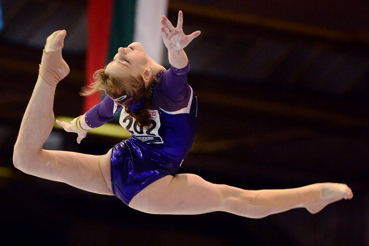 Russia's Anastasia Grishina performs on the balance beam, during the team finals at the European Women's Artistic Gymnastics Championships in Brussels, Saturday, May 12, 2012. Romania won the team final with Russia placed second and Italy placed third. (AP Photo/Geert Vanden Wijngaert)