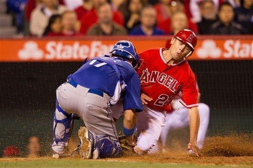 Los Angeles Dodgers catcher A.J. Ellis tags out Los Angeles Angels' Peter Bourjos at home plate during the sixth inning of a spring baseball game, Monday, April 2, 2012, in Anaheim, Calif. (AP Photo/Jeff Lewis)
