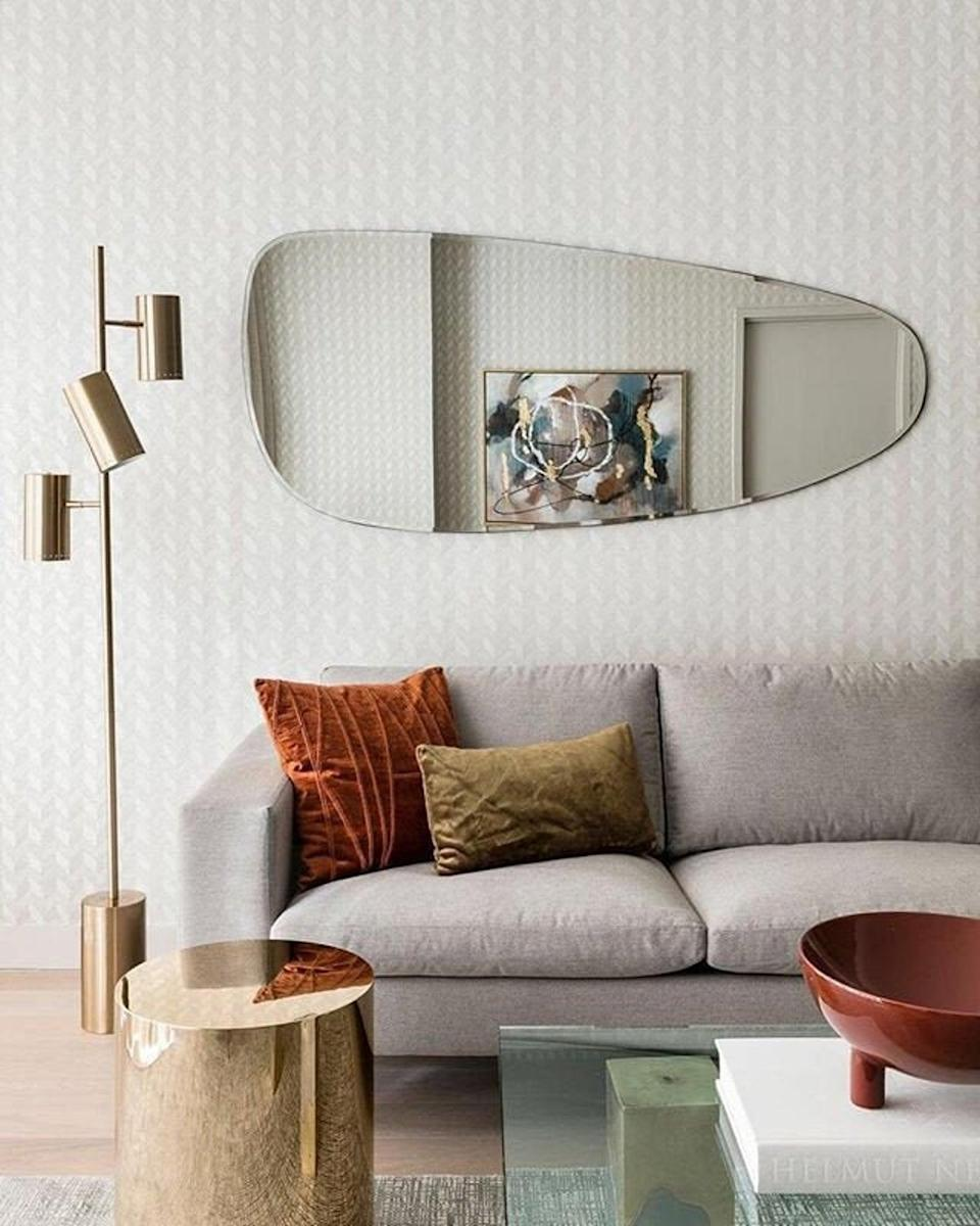 <p>This <span>Asymmetrical Mirror</span> ($299 and up, originally $399 and up) will look great in your living room.</p>
