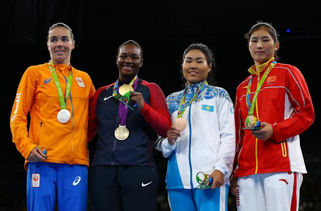 2016 Rio Olympics - Boxing - Victory Ceremony - Women's Middle (75kg) Victory Ceremony - Riocentro - Pavilion 6 - Rio de Janeiro, Brazil - 21/08/2016. (From L) Silver medallist Nouchka Fontijn (NED) of Netherlands, gold medallist Claressa Shields (USA) of USA and bronze medallists Dariga Shakimova (KAZ) of Kazakhstan and Li Qian (CHN) of China pose with their medals. REUTERS/Peter Cziborra FOR EDITORIAL USE ONLY. NOT FOR SALE FOR MARKETING OR ADVERTISING CAMPAIGNS.