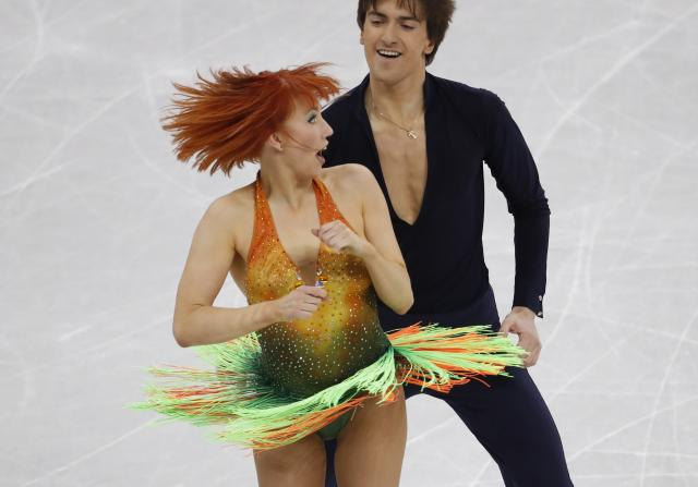 <p>Tiffani Zagorski and Jonathan Gurreiro, Olympic athletes from Russia, perform. REUTERS/Damir Sagolj </p>