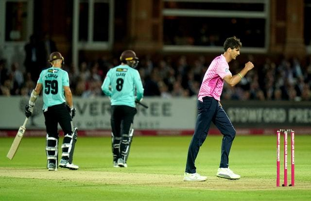 Steven Finn celebrates dismissing Surrey's Tom Curran during a Vitality Blast match at Lord's