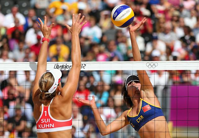 LONDON, ENGLAND - JULY 30: Xi Zhang of China is blocked by Simone Kuhn of Switzerland during the Women's Beach Volleyball Preliminary match between China and Switzerland on Day 3 of the London 2012 Olympic Games at Horse Guards Parade on July 30, 2012 in London, England. (Photo by Ryan Pierse/Getty Images)