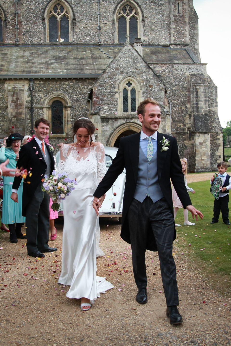 <p><strong>Wedding dress:</strong> Delphine Manivet from the Mews of Notting Hill </p><p><strong>Lace top and veil:</strong> Rime Arodaky from the Mews of Notting Hill </p><p><strong>Shoes:</strong> Tabitha Simmons</p><p><strong>Jewellery:</strong> Debbie Graham Jewellery</p>