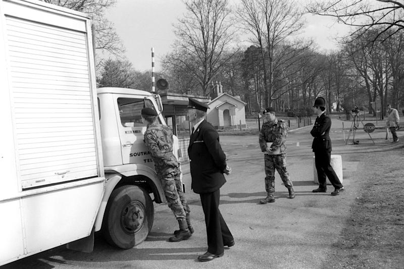 A photo of policemen and soldiers searching cars and lorries in the neighbourhood of the Princess Anne's home at Sandhurst College, where she was resting after an attempted kidnapping in Pall Mall.