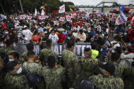 Police block protesters as they try to march towards the House of Representative where Philippine President Rodrigo Duterte is set to deliver his final State of the Nation Address in Quezon city, Philippines on Monday, July 26, 2021. Duterte is winding down his six-year term amid a raging pandemic and a battered economy. (AP Photo/Gerard Carreon)