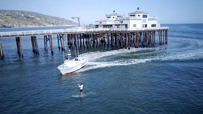 """A man paddle boarding near the Malibu Pier was arrested Thursday after authorities said he disobeyed lifeguards and violated a statewide stay-at-home order amid the coronavirus pandemic. <span class=""""copyright"""">(Los Angeles County Sheriff's Department )</span>"""