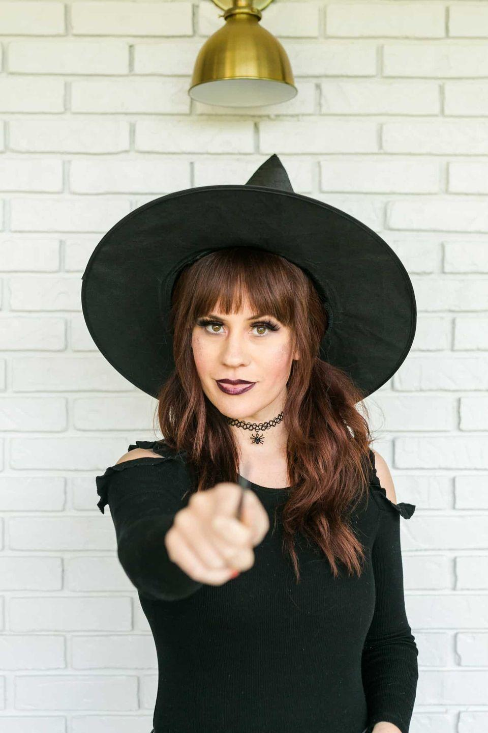 """<p>Embrace your most nostalgic inner goth with this glamorous '90s-inspired witch look.</p><p><strong>Get the tutorial at <a href=""""https://abeautifulmess.com/2018/10/5-easy-clean-beauty-halloween-looks.html"""" rel=""""nofollow noopener"""" target=""""_blank"""" data-ylk=""""slk:A Beautiful Mess"""" class=""""link rapid-noclick-resp"""">A Beautiful Mess</a>.</strong></p><p><strong><a class=""""link rapid-noclick-resp"""" href=""""https://www.amazon.com/NYX-PROFESSIONAL-MAKEUP-Lipstick-Digger/dp/B01EZ8M8TS/?tag=syn-yahoo-20&ascsubtag=%5Bartid%7C10050.g.28304812%5Bsrc%7Cyahoo-us"""" rel=""""nofollow noopener"""" target=""""_blank"""" data-ylk=""""slk:SHOP DARK LIPSTICKS"""">SHOP DARK LIPSTICKS</a><br></strong></p>"""