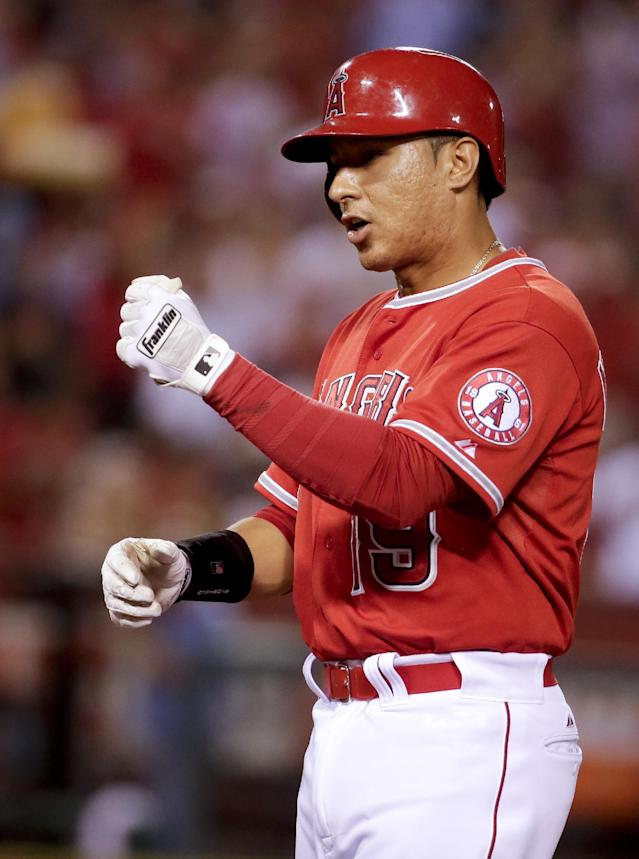 Los Angeles Angels' Efren Navarro celebrates his RBI single against the Detroit Tigers during the sixth inning of a baseball game in Anaheim, Calif., Friday, July 25, 2014. (AP Photo/Chris Carlson)