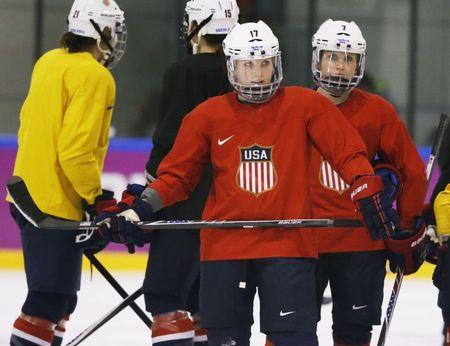 USA forwards Jocelyne Lamoureux (17) and Monique Lamoureux (7) look on during a women's ice hockey team practice at the 2014 Sochi Winter Olympics February 19, 2014. REUTERS/Lucy Nicholson