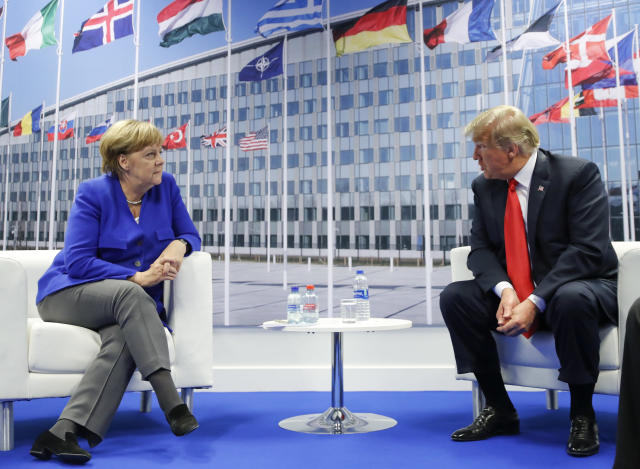 <p>President Trump looks toward German Chancellor Angela Merkel during their bilateral meeting, Wednesday, July 11, 2018, in Brussels. (Photo: Pablo Martinez Monsivais/AP) </p>