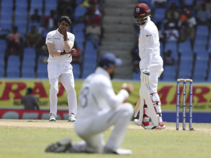 India's bowler Jasprit Bumrah gestures after captain Virat Kohli dropped the catch of a shot played by West Indies' Shimron Hetmyer during day four of the first Test cricket match at the Sir Vivian Richards cricket ground in North Sound, Antigua and Barbuda, Sunday, Aug. 25, 2019. (AP Photo/Ricardo Mazalan)