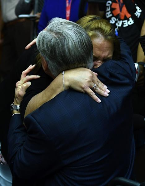 Texas Governor Greg Abbott embraces a grieving worshiper at Arcadia First Baptist Church at a memorial service for the victims of a mass shooting at Santa Fe High School (AFP Photo/Brendan Smialowski)