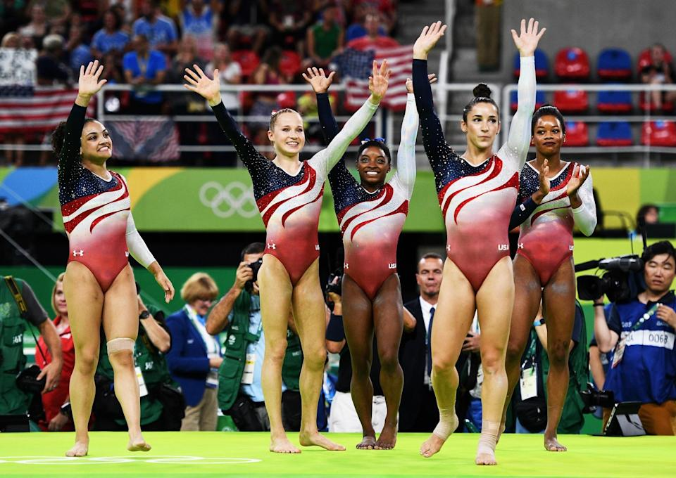 <p>(L to R) Lauren Hernandez, Madison Kocian, Simone Biles, Alexandra Raisman and Gabrielle Douglas of the United States celebrate winning the gold medal during the Artistic Gymnastics Women's Team Final on Day 4 of the Rio 2016 Olympic Games at the Rio Olympic Arena on August 9, 2016 in Rio de Janeiro, Brazil. (Photo by David Ramos/Getty Images) </p>